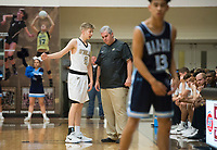 NWA Democrat-Gazette/CHARLIE KAIJO Bentonville High School head coach Dick Rippee (center right) talks to Bentonville High School forward Colton Simmons (2) during a basketball game on Friday, January 12, 2018 at Bentonville High School in Bentonville.