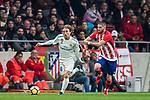 Luka Modric (l) of Real Madrid competes for the ball with Yannick Ferreira Carrasco of Atletico de Madrid during the La Liga 2017-18 match between Atletico de Madrid and Real Madrid at Wanda Metropolitano  on November 18 2017 in Madrid, Spain. Photo by Diego Gonzalez / Power Sport Images