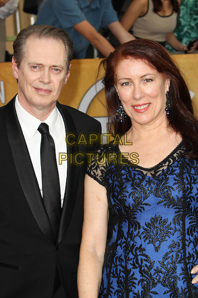 LOS ANGELES, CA - JANUARY 18: Steve Buscemi, Jo Andres attending the 2014 SAG Awards in Los Angeles, California on January 18, 2014. <br /> CAP/MPI/RTNUPA<br /> &copy;RTNUPA/MPI/Capital Pictures