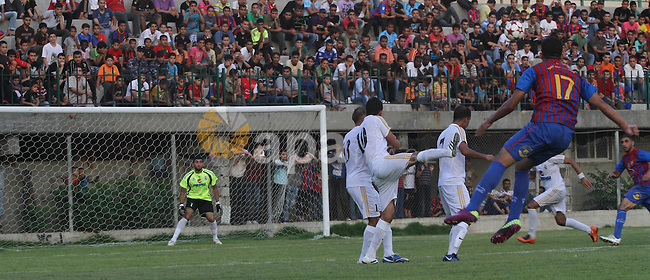 "Spanish team Barcelona celebrates the  victory over arch-rivals Real Madrid on penalties after the end of the game, where held on the stadium Palestine in Gaza city on Friday, on Sep. 30, 2011. The Ministry of Youth and Sports organized this game under the auspices of a company ""Jawwal"", to highlight the suffering of Gaza and to support Palestinian sports. Photo by Mohammed Asad"