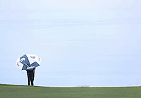 25 JAN 13 Keegan Bradley watches the steady rain over the Pacific Ocean during Friday's Second Round action  at The Farmers Insurance Open at Torrey Pines Golf Course in La Jolla, California. (photo:  kenneth e.dennis / kendennisphoto.com)