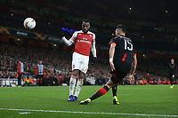 Rennes' Ramy Bensebaini and Arsenal's Alexandre Lacazette<br /> <br /> Photographer Rob Newell/CameraSport<br /> <br /> Football - UEFA Europa League Round of 16 Leg 2 - Arsenal v Rennes - Thursday 14th March 2019 - The Emirates - London<br />  <br /> World Copyright © 2018 CameraSport. All rights reserved. 43 Linden Ave. Countesthorpe. Leicester. England. LE8 5PG - Tel: +44 (0) 116 277 4147 - admin@camerasport.com - www.camerasport.com