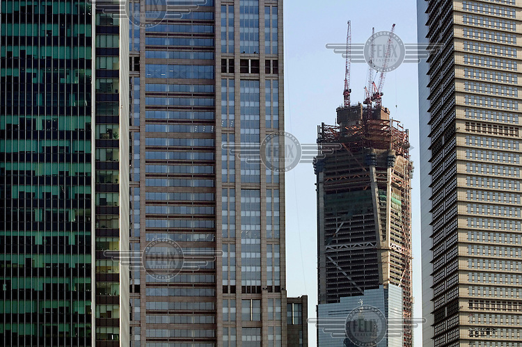 The construction of the Shanghai World Financial Centre underway in the Pudong district. Once complete, the structure will be one of the world's tallest buildings at 101 storeys and measuring 492 metres tall.