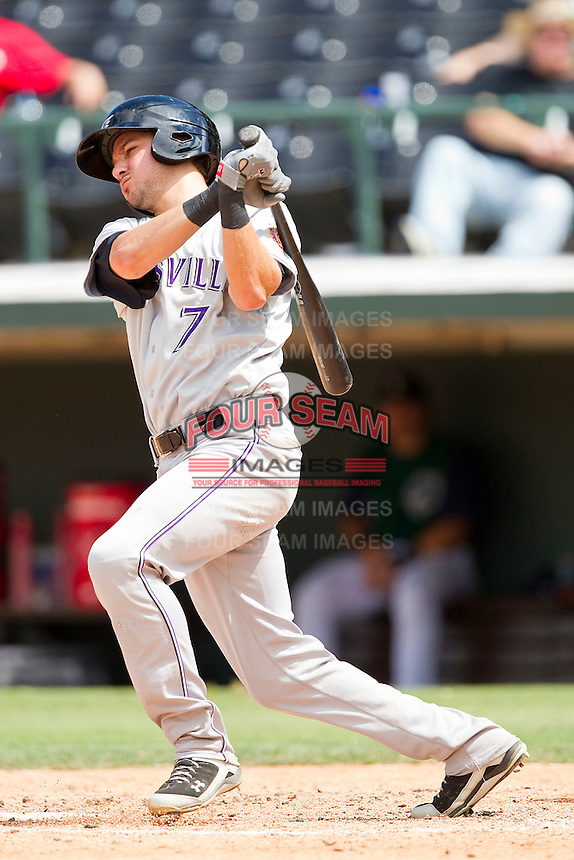 Paul Janish #7 of the Louisville Bats follows through on his swing against the Charlotte Knights at Knights Stadium on July 17, 2011 in Fort Mill, South Carolina.  The Knights defeated the Bats 7-6.   (Brian Westerholt / Four Seam Images)