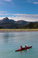 Tourists kayak in Nellie Juan Lagoon, Prince William Sound, Chugach National Forest, Kenai Peninsula, southcentral, Alaska.