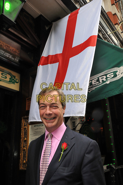 Nigel Farage, leader of UKIP.Peter Stringfellow backs the UK Independence Party (UKIP) candidate Earl of Bradford, Richard Bridgeman, in a forthcoming Westminster Council by-election, Porters Restaurant, London, England..April 23rd, 2012.half length suit red rose flower grey gray pink shirt smiling .CAP/BF.©Bob Fidgeon/Capital Pictures.