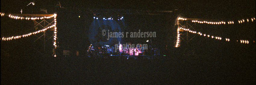 John Scher on Stage during the Grateful Dead in Concert at Raceway Park, Englishtown NJ on 3 September 1977. Labor Day Weekend. View from about 200 feet back from stage, offset stage right.