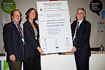 (l-r) Josh Karliner from Health Care Without Harm, Genon Jensen from Health and Envrionment Alliance present a prescription for the planet to Dr. Roberto Bertollini from WHO at the Barcelona Climate Talks (©Robert vanWaarden ALL RIGHTS RESERVED)