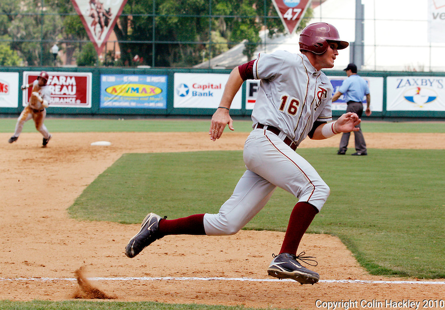 TALLAHASSEE, FL 6/12/10-FSU-VANDY BASE10 CH-Florida State's Jayce Boyd, right, digs for home during hte sixth inning as Devon Travis rounds second against Vanderbilt Saturday during NCAA Super Regional action at Dick Howser Stadium in Tallahassee.  Boyd was thrown out at second. The Commodores beat the Seminoles 6-2 to stay alive for game three...COLIN HACKLEY PHOTO