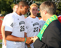 Harold Mayne-Nicholls greets George Mason players during the visit of the FIFA World Cup 2018-2022 inspection delegation to George Mason University soccer practice facility.