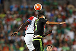 15 July 2015: Diego Reyes (MEX) (5) and Kenwyne Jones (TRI) (behind). The Mexico Men's National Team played the Trinidad & Tobago Men's National Team at Bank of America Stadium in Charlotte, NC in a 2015 CONCACAF Gold Cup Group C match.