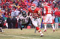 Chiefs running back Larry Johnson leaves Jacksonville Jaguars defensive end Bobby McCray grasping for air as he runs around the left end for a two yard touchdown during the third quarter at Arrowhead Stadium in Kansas City, Missouri on December 31, 2006. The Chiefs won 35-30.