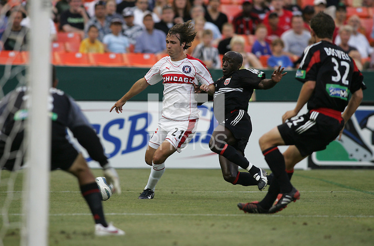 June 15, 2005; Washington, DC, USA; DC United defender John Wilson (27) tries to stop Chicago Fire midfielder Justin Mapp (21) from shooting the ball at RFK Stadium. DC United  won the game, 4-3.