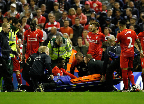 20.04.2016. Anfield, Liverpool, England. Barclays Premier League. Liverpool versus Everton. Liverpool striker Divock Origi receives treatment before being stretchered off early in the second half.