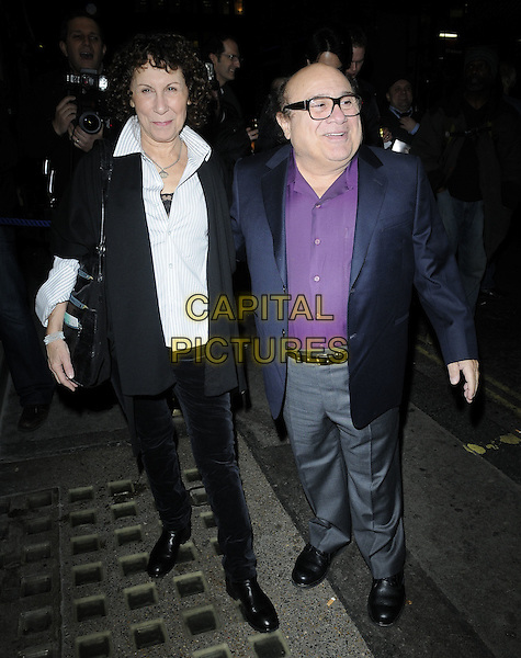 "RHEA PERLMAN & DANNY DEVITO  .Attends the Press night for ""The Children's Hour"" at the Comedy Theatre, London, England, UK, .February 9th 2011..full length married couple husband wife purple shirt suit black white glasses jacket .CAP/CAN.©Can Nguyen/Capital Pictures."