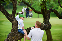 A young fan watches from a tree as the next group of golfers approach the 7th green during round 3 of  the Volunteers of America Texas Shootout Presented by JTBC, at the Las Colinas Country Club in Irving, Texas, USA. 4/29/2017.<br /> Picture: Golffile | Ken Murray<br /> <br /> <br /> All photo usage must carry mandatory copyright credit (&copy; Golffile | Ken Murray)