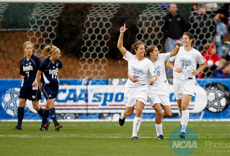 03 DEC 2006:  Tobin Heath (98) and Yael Averbuch (17) congratulate teammate Casey Nogueira (23) of the University of North Carolina after her goal against Notre Dame University during the Division I Women's Soccer Championship held at the SAS Soccer Park in Cary, NC.  North Carolina defeated Notre Dame 2-1 for the national title.  Jamie Schwaberow/NCAA Photos