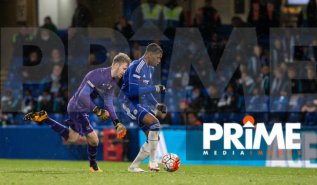 Dujon Sterling of Chelsea U18 punches on a Goalkeeper Daniel Grimshaw of Manchester City U18 mistake to score the first goal  during the FA Youth Cup FINAL match between Chelsea U18 and Man City U18 at Stamford Bridge, London, England on 27 April 2016. Photo by Andy Rowland.
