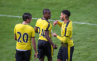 Odion Ighalo (centre) of Watford celebrates the first goal during the Pre Season Friendly match between Woking and Watford at the Kingfield Stadium, Woking, England on 10 July 2016. Photo by Andy Rowland.