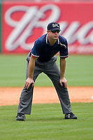 Umpire Joseph Born handles the calls on the bases during a South Atlantic League game between the Kannapolis Intimidators and the Greensboro Grasshoppers at NewBridge Bank Park June 20, 2009 in Greensboro, North Carolina. (Photo by Brian Westerholt / Four Seam Images)