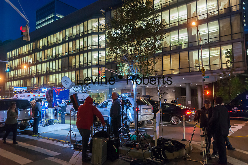 Members of the media camp out in front of  Bellevue Hospital in New York on Friday, October 24, 2014 where Dr. Craig Spencer, the first Ebola patient in the city, is being treated. Dr. Spencer is a member of Doctors Without Borders and has recently returned from treating Ebola patients in Guinea.  (© Richard B. Levine)