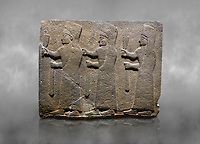 Hittite monumental relief sculpted orthostat stone panel of a Procession. Basalt, Karkamıs, (Kargamıs), Carchemish (Karkemish), 900-700 B.C.  Marching female figures. Anatolian Civilisations Museum, Ankara, Turkey.<br /> <br /> It is a depiction of three marching female figures in long dress with a high headdress at their head. These women are considered to be the nuns of the Goddess Kubaba. They have a bunch of Spica in their right hand, and objects similar to a sceptre in their left hand.