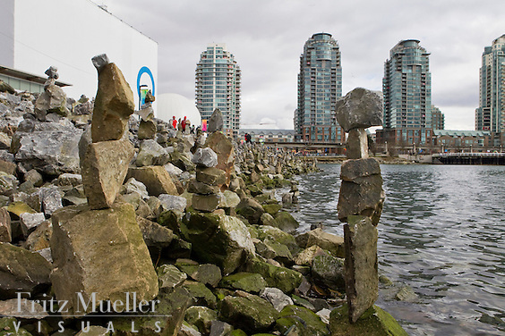 Inuksuks line the shore along False Creek in Vancouver