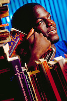 Portrait of African-American high school boy surrounded by books