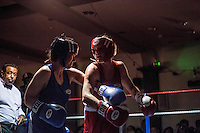 Two female boxers fight in the ring at the London Irish Centre where the 'Carpe Diem' white collar boxing event is taking place. <br /> <br /> 'White-collar boxing' is a growing phenomenon amongst well paid office workers and professionals and has seen particular growth in financial centres like London, Hong Kong and Shanghai. It started at a blue-collar gym in Brooklyn in 1988 with a bout between an attorney and an academic and has since spread all over the world. The sport is not regulated by any professional body in the United Kingdom and is therefore potentially dangerous, as was proven by the death of a 32-year-old white-collar boxer at an event in Nottingham in June 2014. The London Irish Centre, amongst other venues, hosts a regular bout called 'Carpe Diem'. At most bouts participants fight to win. Once boxers have completed a few bouts they can participate in 'title fights' where they compete for a replica 'belt'.