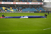 9th February 2020; The Den, London, England; English Championship Football, Millwall versus West Bromwich Albion; EFL giant banner blows around as the ground staff try to gather in during Storm Ciara - Strictly Editorial Use Only. No use with unauthorized audio, video, data, fixture lists, club/league logos or 'live' services. Online in-match use limited to 120 images, no video emulation. No use in betting, games or single club/league/player publications