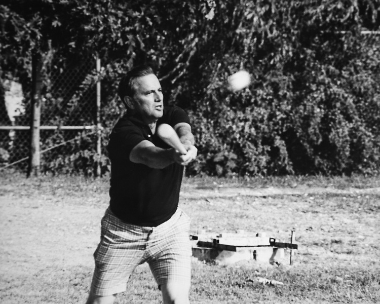 Secretary of the Treasury James Baker playing baseball. 1985 (Photo by CQ Roll Call via Getty Images)