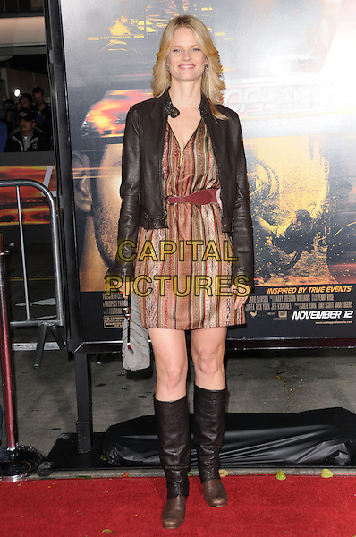 "JOELLE CARTER .attends the Twentieth Century Fox's L.A. Premiere of ""Unstoppable"" held at Regency Village Theater in Westwood, California, USA, October 26th 2010..full length leather jacket brown striped dress knee high boots black.CAP/RKE/DVS.©DVS/RockinExposures/Capital Pictures."