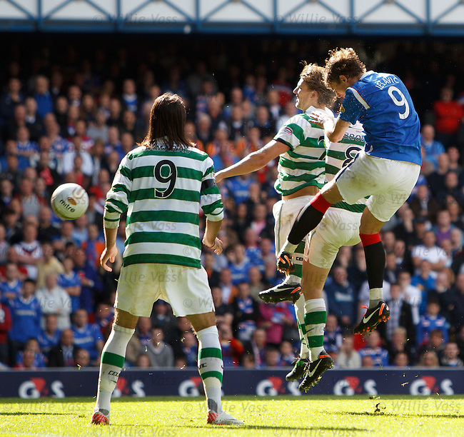 Nikica Jelavic beats Glenn Loovens and Scott Brown to head the second goal for Rangers