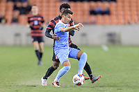 Houston, TX - Friday December 9, 2016: Nico Melo (31) of the North Carolina Tar Heels and Bryce Marion (7) of the Stanford Cardinal battle for control of the ball at the NCAA Men's Soccer Semifinals at BBVA Compass Stadium in Houston Texas.