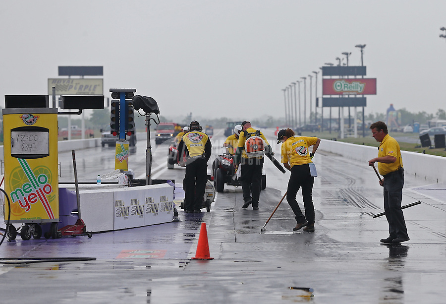 Apr. 27, 2013; Baytown, TX, USA: NHRA Safety safari make an attempt to dry the track during a break in the rain during qualifying for the Spring Nationals at Royal Purple Raceway. Mandatory Credit: Mark J. Rebilas-