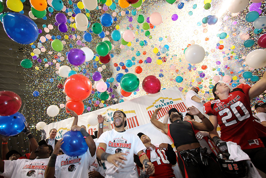 Texas Tech players celebrate the win in a shower of balloons after the Valero Alamo Bowl, Saturday, Jan. 2, 2010, at the Alamodome in San Antonio. Texas Tech won 41-31. (Darren Abate/pressphotointl.com)