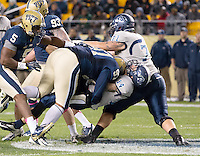 Pitt defenisve lineman Aaron Donald (97) puts a hit on Old Dominion quarterback Taylor Heinicke (14). The Pitt Panthers defeated the Old Dominion Monarchs 35-24 at Heinz Field, Pittsburgh, Pennsylvania on October 19, 2013.