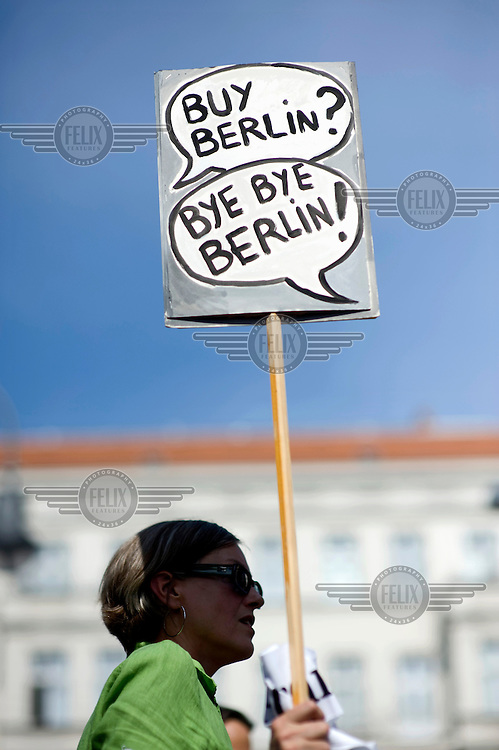 A woman holds a poster reading 'Buy Berlin? Bye Bye Berlin!' Demonstration against the increase in rents and social dispacement during a rally in Berlin Kreuzberg and Neukoelln. Protesters are unhappy with a steady process of gentrification which is rapidly forcing poorer residents out of the city centre and tearing apart the city's social fabric. .