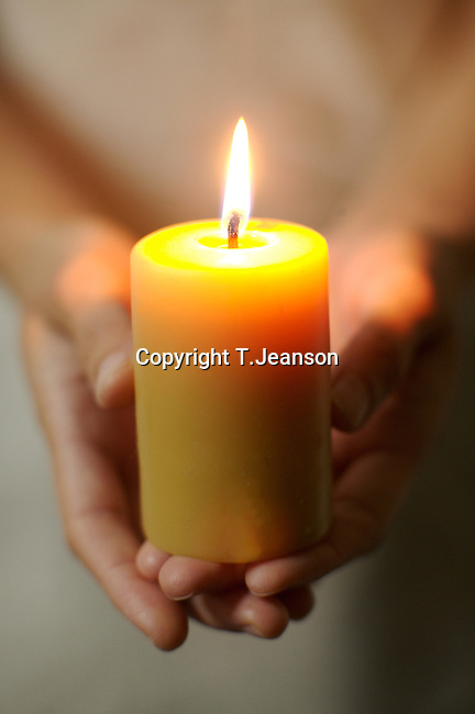 hand & candle