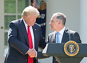 United States President Donald J. Trump shakes hands with EPA Administrator Scott Pruitt after making a statement  regarding the Paris Accord in the Rose Garden of the White House in Washington, DC on Thursday, June 1, 2017.  The President announced the US will withdraw from the accord.<br /> Credit: Ron Sachs / CNP