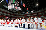 MADISON, WI - SEPTEMBER 29: The Wisconsin Badgers women's hockey team watches their new banner as it is dropped prior to the opening game against the Quinnipiac Bobcats at the Kohl Center on September 29, 2006 in Madison, Wisconsin. The Badgers beat the Bobcats 3-0. (Photo by David Stluka)