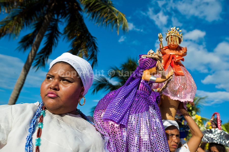 Baiana women carry religious figurines during the ritual procession in honor to Yemanjá, the Candomblé goddess of the sea, in Amoreiras, Bahia, Brazil, 3 February 2012. Yemanjá, originally from the ancient Yoruba mythology, is one of the most popular ?orixás?, the deities from the Afro-Brazilian religion of Candomblé. Every year on February 3rd, hundreds of Yemanjá devotees participate in a colorful celebration in her honor. Faithful, usually dressed in the traditional white, gather at the beach on Itaparica island to leave offerings for their goddess. Gifts for Yemanjá include flowers, perfumes or jewelry. Dancing in the circle and singing ancestral Yoruba prayers, sometimes the followers enter into a trance and become possessed by the spirits. Although Yemanjá is widely worshipped throughout Latin America, including south of Brazil, Uruguay, Cuba or Haiti, the most popular cult is maintained in Bahia, Brazil.