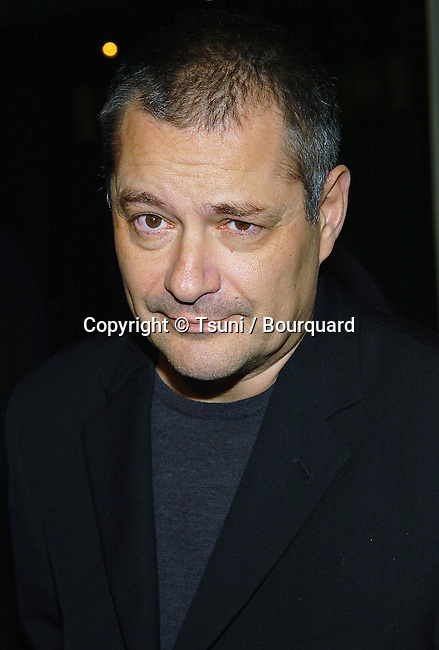 The director Jean-Pierre Jeunet arriving at the A Very Long Engagement Premiere at the Grauman Chinese Theatre in Los Angeles. November 10, 2004.