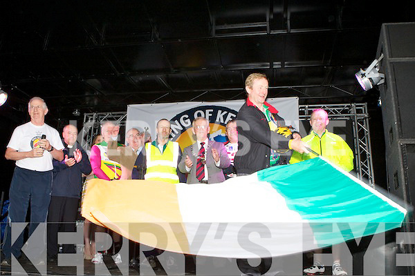 Taoiseach Enda Kenny waves the flag to start the 2012 Ring of Kerry cycle in Killarney racescourse on Saturday morning..
