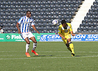 Ellis Plummer heads past Michael Ngoo in the Kilmarnock v St Mirren Scottish Professional Football League Premiership match played at Rugby Park, Kilmarnock on 13.9.14.