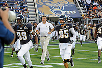 1 October 2011:  FIU Football Head Coach Mario Cristobal takes the field with his team prior to the game.  The Duke University Blue Devils defeated the FIU Golden Panthers, 31-27, at FIU Stadium in Miami, Florida.