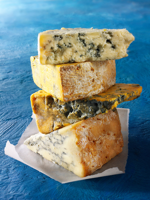 British Blue Cheese Photos -From the top - Blue Vinney, Stilton, Blacksticks Blue, Creamy Stilton. Funky Stock Photos.