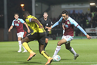 Burnley's Dwight McNeil battles with Burton Albion's Lucas Atkins<br /> <br /> Photographer Mick Walker/CameraSport<br /> <br /> The Carabao Cup Round Three   - Burton Albion  v Burnley - Tuesday  25 September 2018 - Pirelli Stadium - Buron On Trent<br /> <br /> World Copyright &copy; 2018 CameraSport. All rights reserved. 43 Linden Ave. Countesthorpe. Leicester. England. LE8 5PG - Tel: +44 (0) 116 277 4147 - admin@camerasport.com - www.camerasport.com