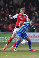 Blackpool's Nathan Delfouneso under pressure from Fleetwood Town's Harry Souttar<br /> Photographer Lee Parker/CameraSport<br /> <br /> The EFL Sky Bet League One - Fleetwood Town v Blackpool - Saturday 7th March 2020 - Highbury Stadium - Fleetwood<br /> <br /> World Copyright © 2020 CameraSport. All rights reserved. 43 Linden Ave. Countesthorpe. Leicester. England. LE8 5PG - Tel: +44 (0) 116 277 4147 - admin@camerasport.com - www.camerasport.com
