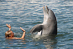 Dolphin trainer works with her charge at Theater of the Sea, an Islamorada, Florida Keys, sea life center